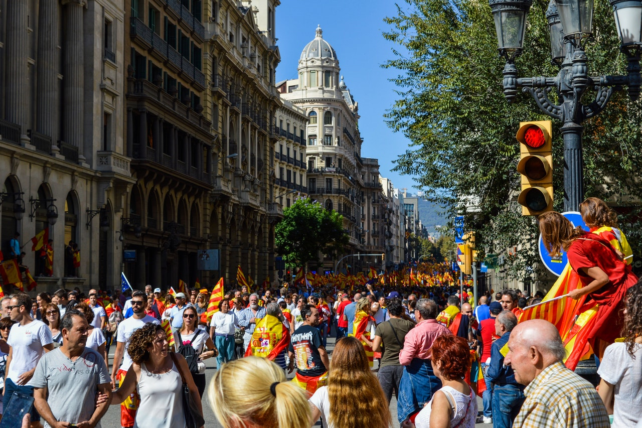 Thousands of people on street celebrate the football victory